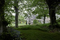 A view through trees toward Trerice House. The house was built in 1573 by Sir John Arundell, replacing a home that he inherited from his father. Sir J...