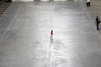 England, London, South Bank, A small child playing in the Turbine Hall of the Tate Modern.