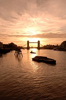 England, London, Tower Bridge, Sunrise behind Tower Bridge. The bridge was opened on 30 June 1894 by the Prince of Wales, the future King Edward VII, ...