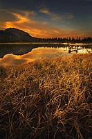 alberta, canada, sunset over a lake and mountains