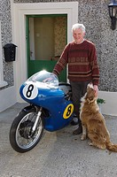 Veteran motorcycle road race champion Richard Creith with his 500cc Manx Norton at his farm at Bushmills, Northern Ireland