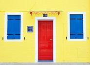 Colourful yellow house in village of Burano near Venice in Italy
