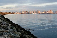 San Diego skyline at dusk, viewed along shoreline, California, USA