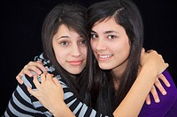 two teenage girls in an embrace