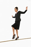 Businesswoman walking on a tightrope