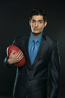 Businessman holding an American football