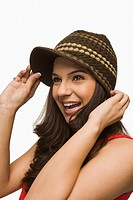 Woman wearing a knit hat and smiling