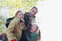 Family laughing outdoors in autumn