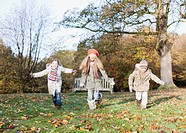 Children running in park in autumn