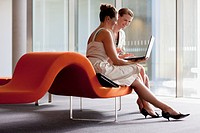 Businesswomen working with laptop in waiting area