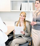 Businesswomen having meeting in office cubicle