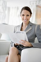Businesswoman reviewing paperwork