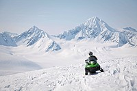 Snowmobiler on Spencer Glacier near the top of Blackstone Glacier, Kenai Mountains, Chugach National Forest, Alaska