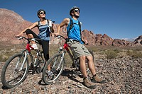 Mountain biker couple taking a break