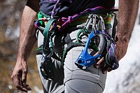 Equipment around waist of rock climber