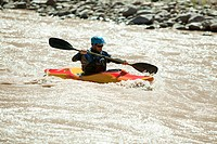 Man white water kayaking