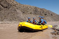 People rafting on river