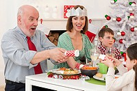 Family enjoying Christmas dinner