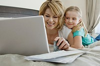 Mother and daugther using laptop