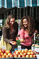 Friends shopping for produce