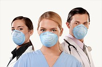 Portrait of doctors wearing flu masks