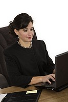 Caucasian businesswoman setting a desk and working on alaptop computer