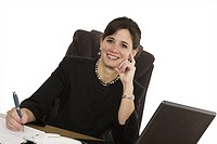 Caucasian businesswoman setting a desk and smiling