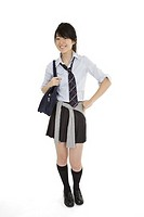 Portrait of a female Asian teenager dressed in the traditional Japanese schoolgirl clothing  Uniforms are worn by most of the female school children i...