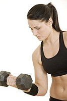 Beautiful Caucasian woman using dumbbells on white background