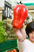 Woman shopping vegetables in a supermarket