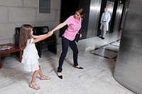 Girl tugging her mother in a hospital