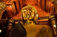 A golden Buddha in one of many old Buddhist temples in and around Ayutthaya, Thailand