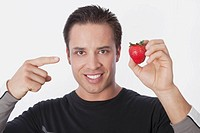 Man holding a strawberry