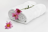 Close_up of rolled up towels with flowers