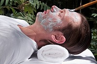 Man applying facial mask