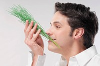 Man smelling aroma herbs