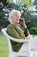 Woman sitting in a chair and talking on a mobile phone