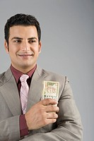 Businessman holding Indian five hundred rupee banknotes
