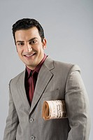 Businessman with a newspaper under his arm