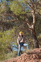 Female forestry engineer in forest