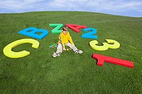 Young Boy in Grass with Giant Alphabet