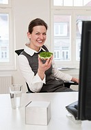 Businesswoman eating healthy snack