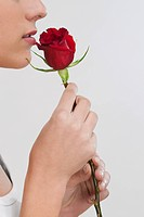 Woman smelling a rose