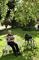 Man sitting on a chair in a park