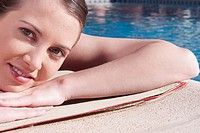Woman resting by a swimming pool