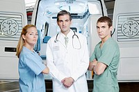Doctor standing with nurses