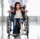 Doctor pushing a patient in a wheelchair