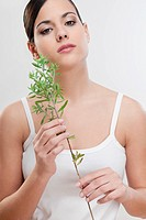 Portrait of a woman holding aroma herbs