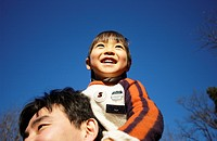 Father carrying son on shoulders, Tokyo Prefecture, Honshu, Japan