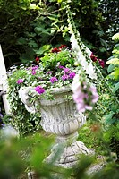 Flowering plants in stone vase in garden